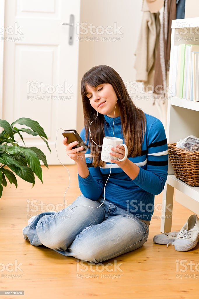 Teenager girl relax home - listen to music royalty-free stock photo