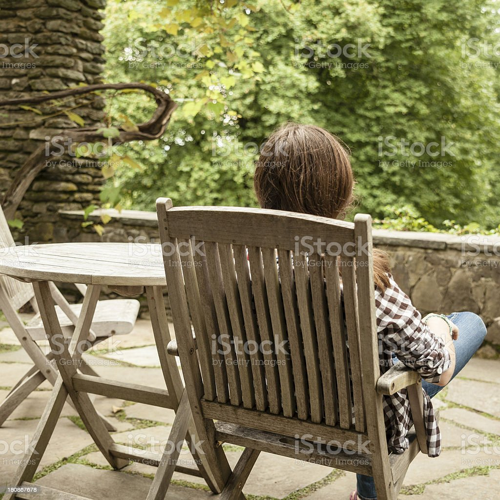 Teenager girl relaxing in the chaise lounge royalty-free stock photo