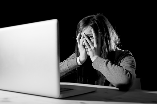 istock teenager girl suffering internet cyber bullying scared and depressed cyberbullying 520546514