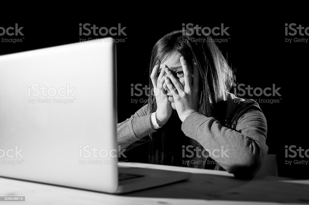 teenager girl suffering internet cyber bullying scared and depressed cyberbullying stock photo