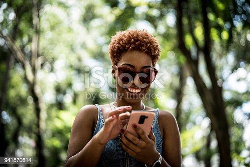 istock Teenager girl using mobile 941570814