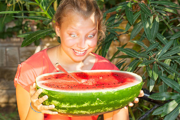 Teenager girl with a watermelon stock photo