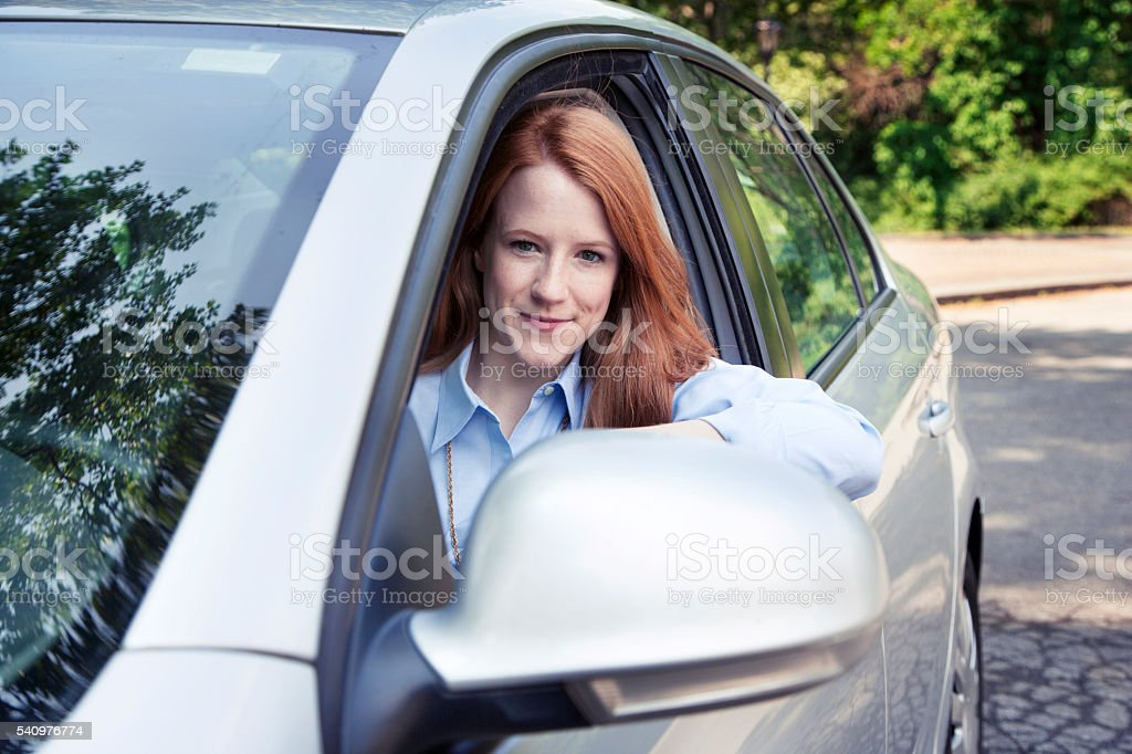 Teenager girl with car stock photo