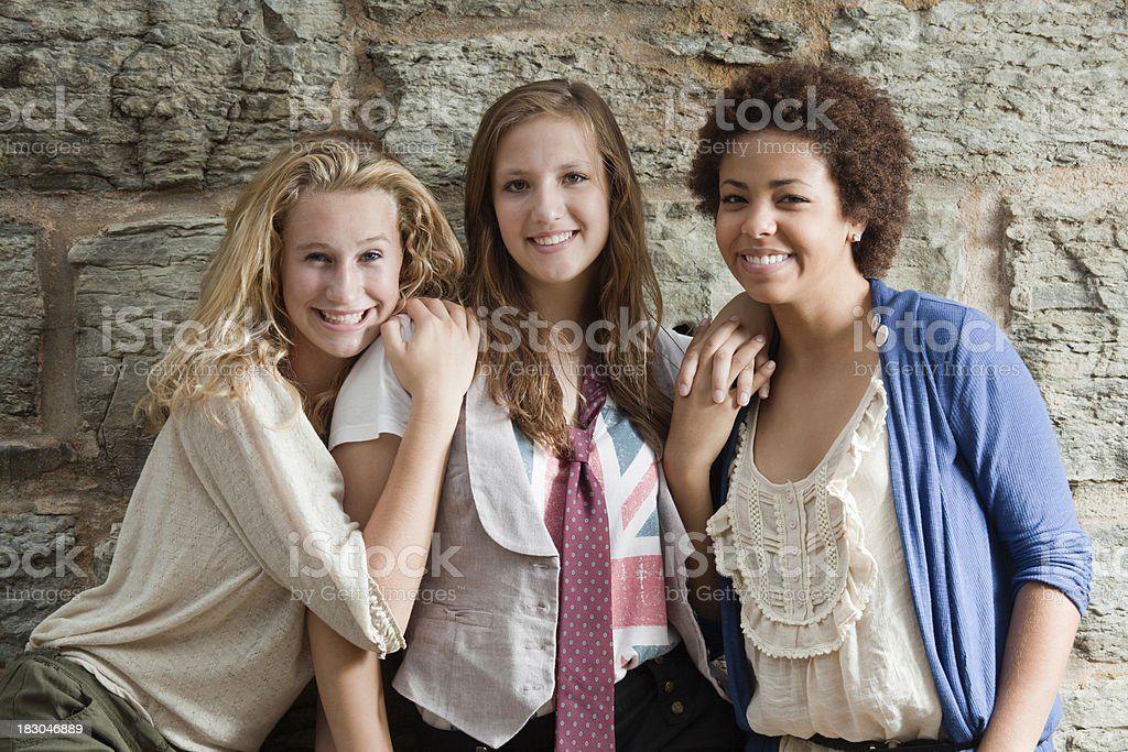 Teenager Girls, Young Best Friends Group Posing by Wall Outdoors royalty-free stock photo