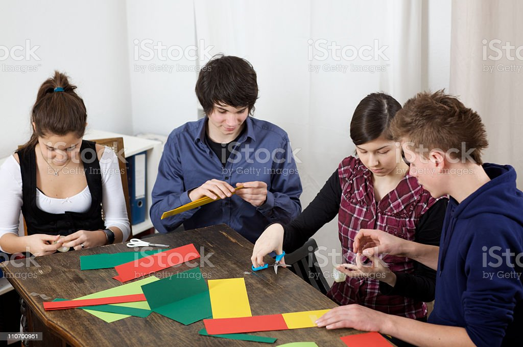 teenager group having fun while doing handicrafts together royalty-free stock photo