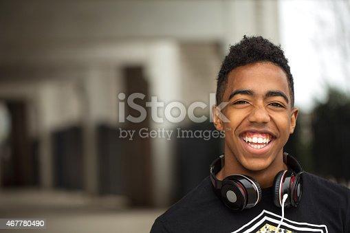 istock Teenager having fun listing to music 467780490