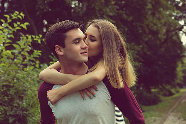 teenager having fun outdoors. - little girls little boys kissing love stock photos and pictures