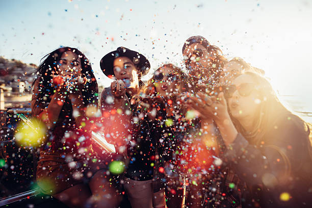 Teenager hipster friends celebrating by blowing colorful confetti picture id518020388?b=1&k=6&m=518020388&s=612x612&w=0&h=5nau4ztiqt4ahzefdwrmttrtfod88pctrgh6jiiwy o=