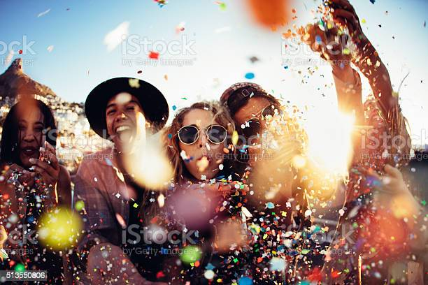 Teenager hipster friends partying by blowing colorful confetti from picture id513550806?b=1&k=6&m=513550806&s=612x612&h=hfcedgzqq3gyd5jznb5wzw7diraolriyzk maku9vac=