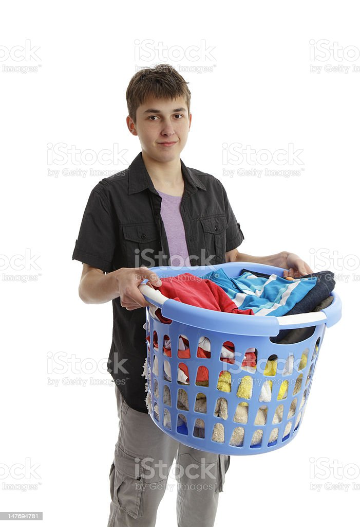 Teenager holding a basket of housework stock photo