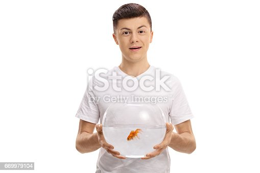 109350576 istock photo Teenager holding a bowl with a goldfish inside 669979104