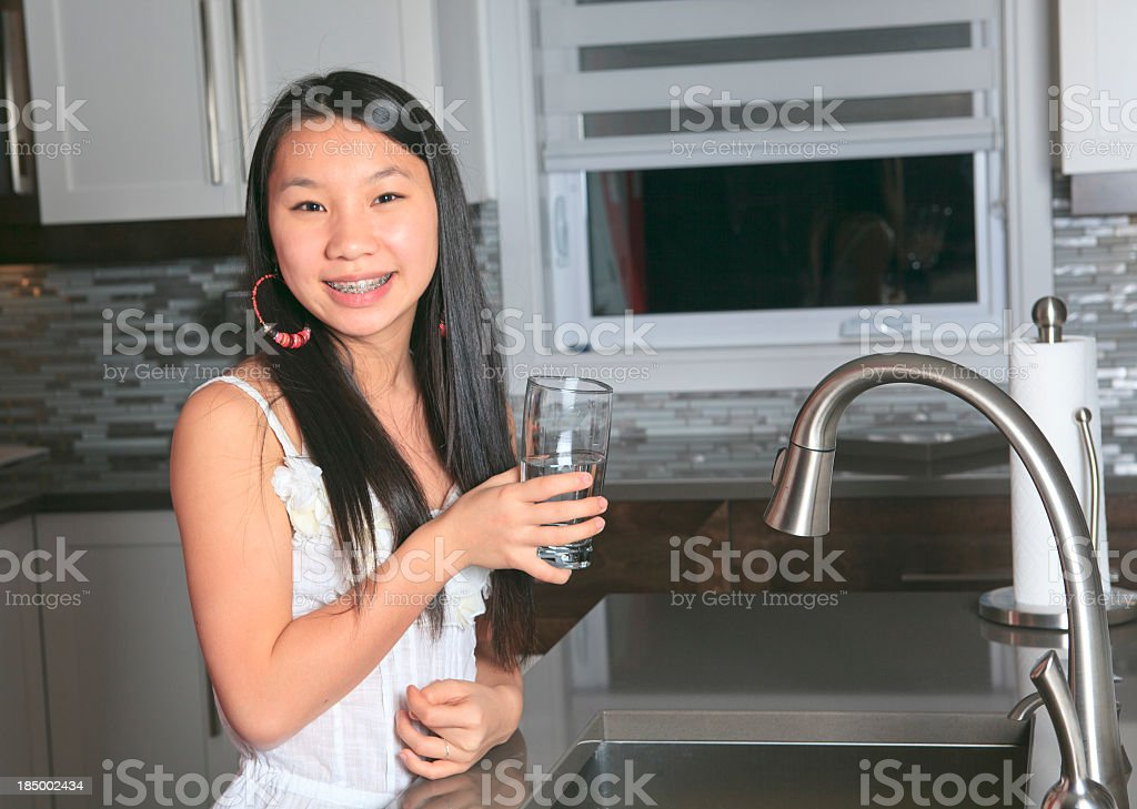 Teenager Home Lifestyle - Kitchen Water Glass royalty-free stock photo
