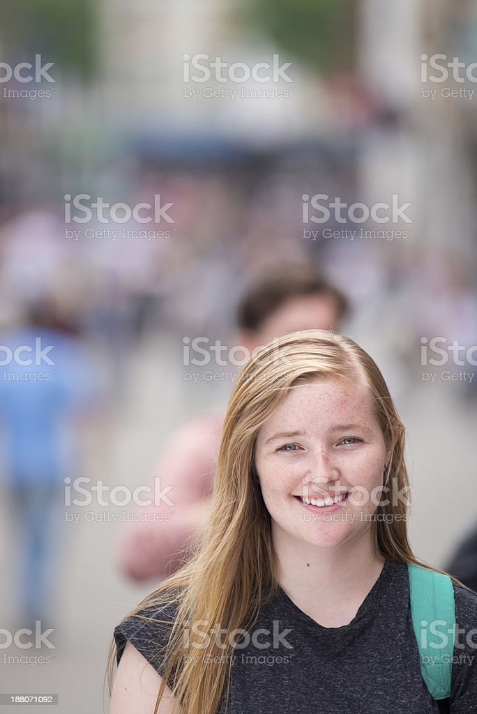 teenager in a busy street scene royalty-free stock photo