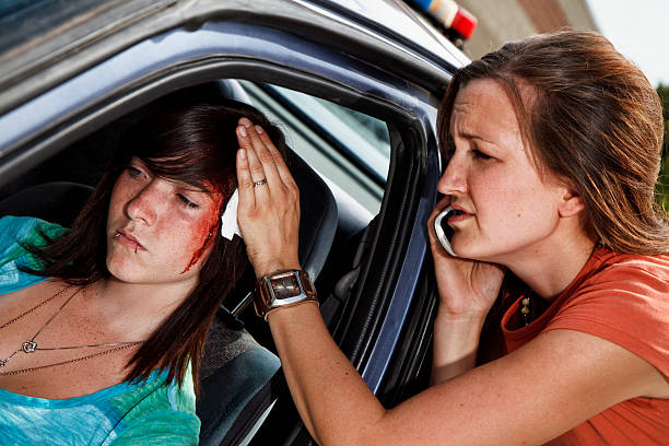 Teenager In A Car Accident, Head Injury stock photo