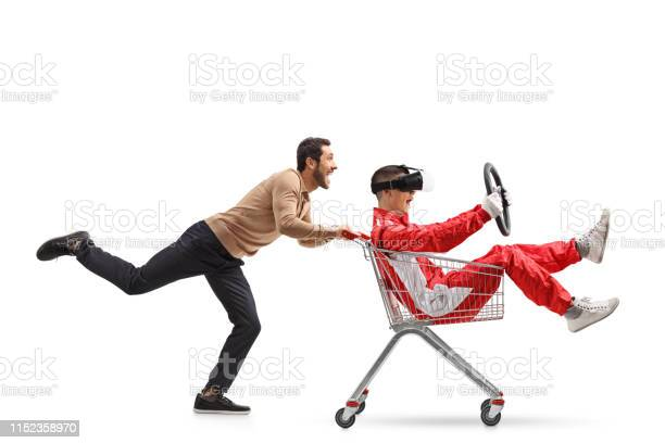 Teenager in a racing suit with vr googles in a shopping cart being picture id1152358970?b=1&k=6&m=1152358970&s=612x612&h=1dmnv09kr3q3qcv5m1du1vfzbuvitws1wmhgaewfeyo=