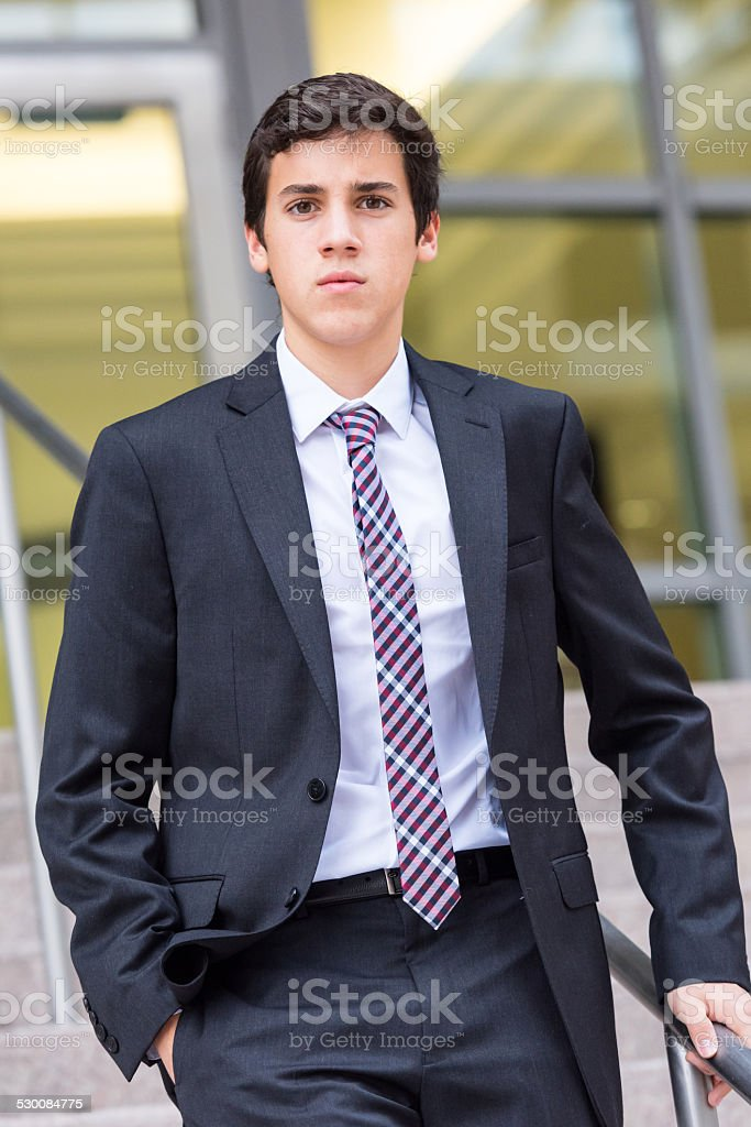 Teenager in a suit stock photo