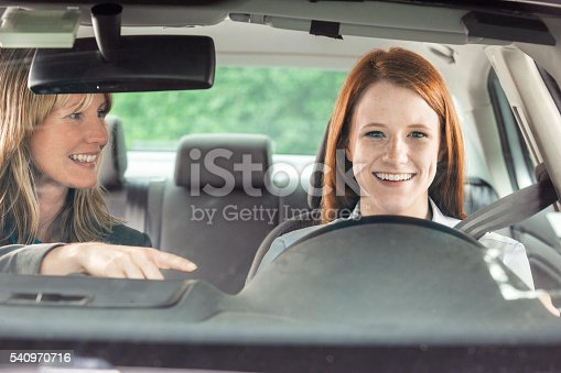 istock Teenager in car with driving instructor 540970716