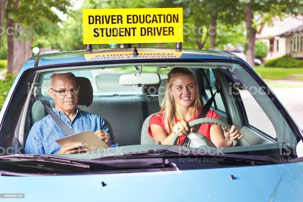 Teenager in Drivers's License Exam with Examiner in Car stock photo