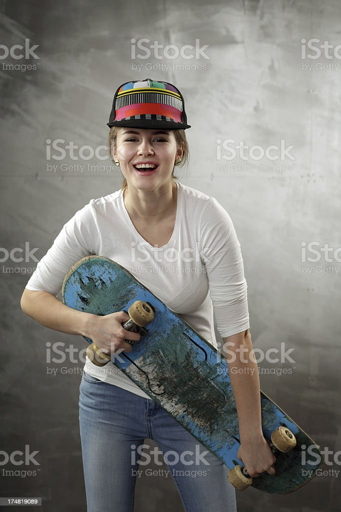 Teenager in studio with skateboard royalty-free stock photo