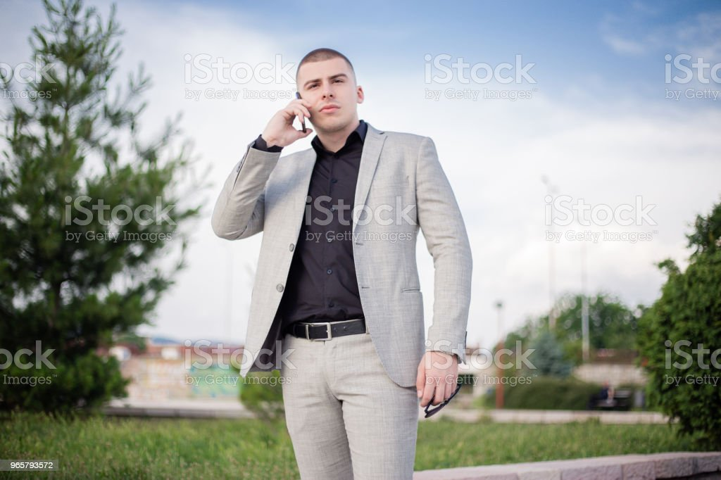 Teenager in the suit talking on mobile phone. - Стоковые фото 18-19 лет роялти-фри