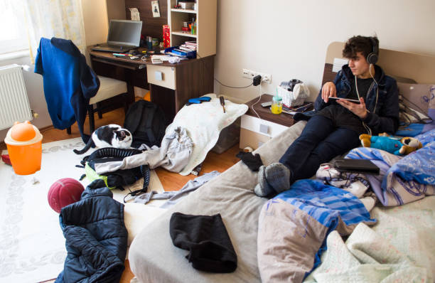 Teenager is resting in his messy room picture id1087232506?b=1&k=6&m=1087232506&s=612x612&w=0&h=tonov0dhkrxt8gtxn9upxnfriblqx13ilqawpqop42m=
