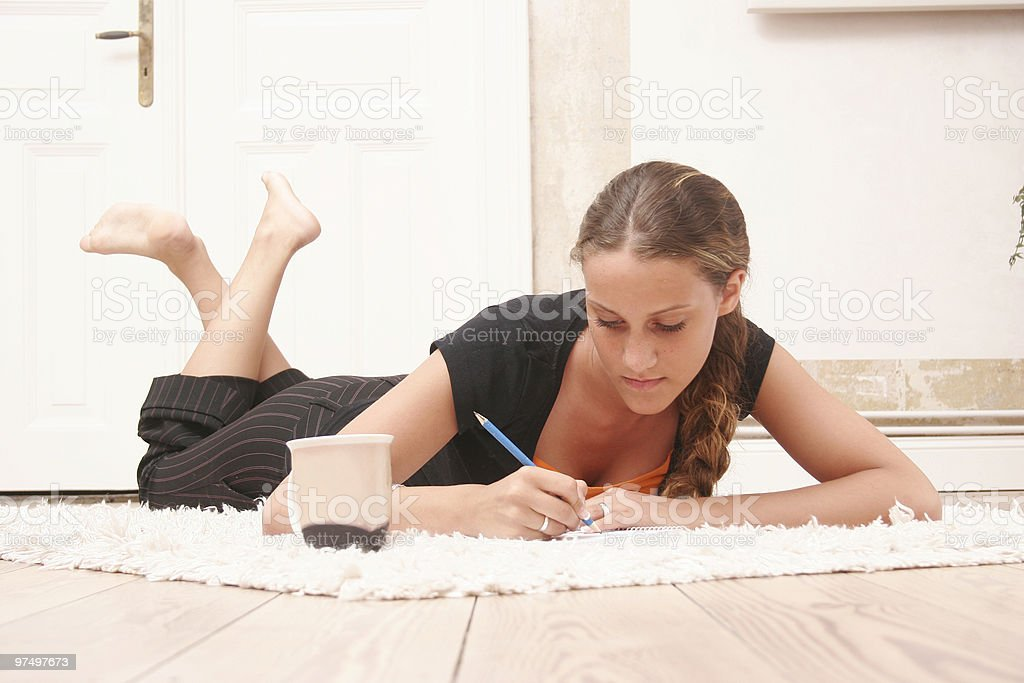 Teenager is writing royalty-free stock photo
