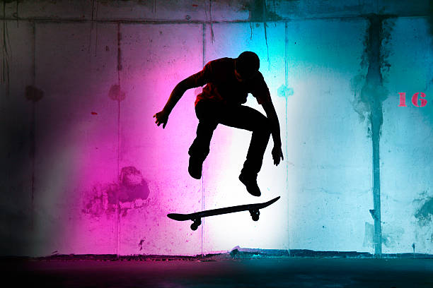 teenager jumping, skateboarding at night black silhouette - skateboard bildbanksfoton och bilder