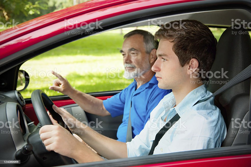 Teenager learning to drive stock photo