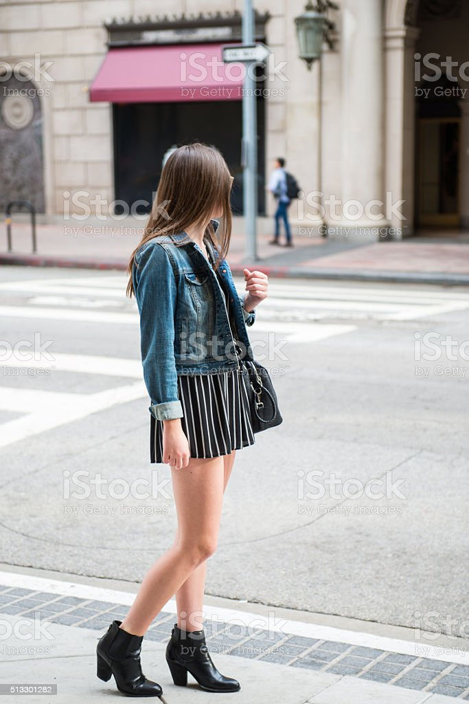 Teenager Looking at Young Man stock photo
