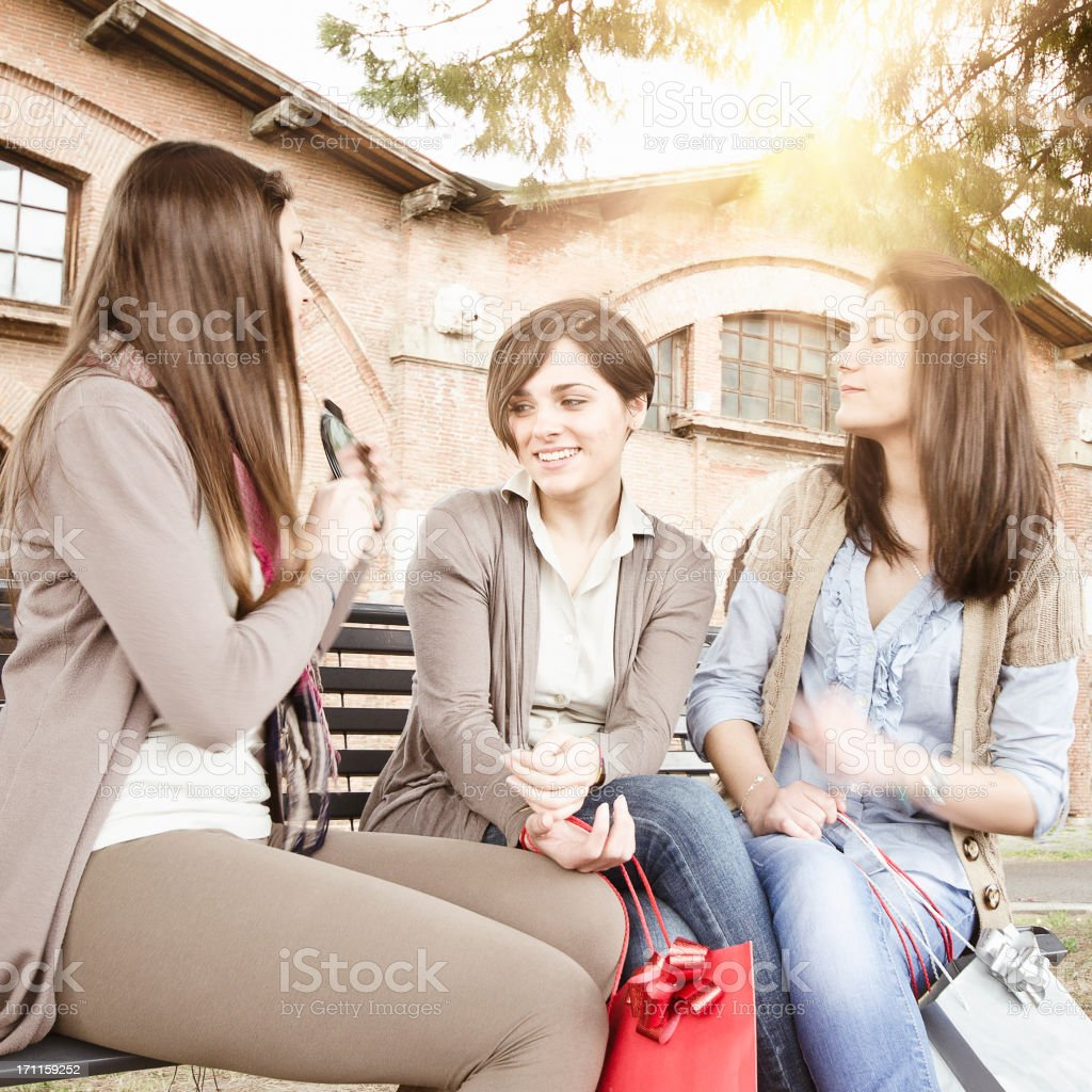Teenager mirroring with friends after the shopping royalty-free stock photo