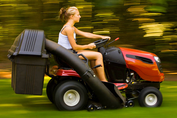teenager mowing the lawn - riding lawn mower stock photos and pictures