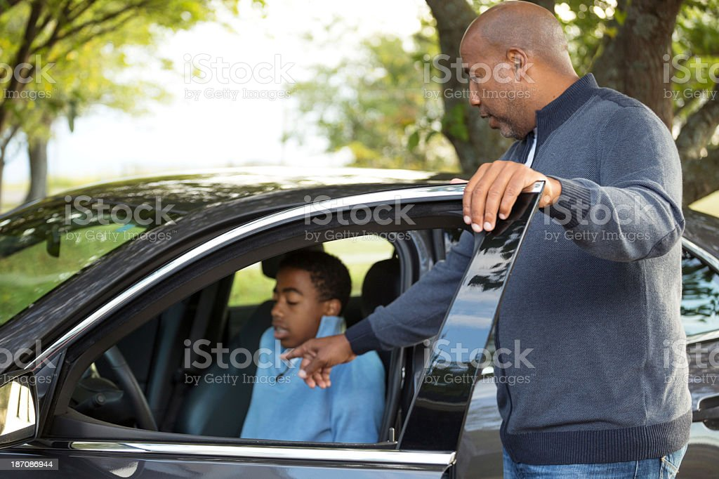 Teenager nervous about driving stock photo