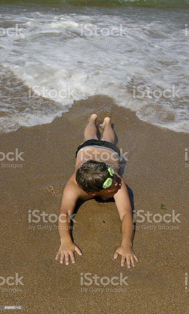 Подросток на пляже Стоковые фото Стоковая фотография