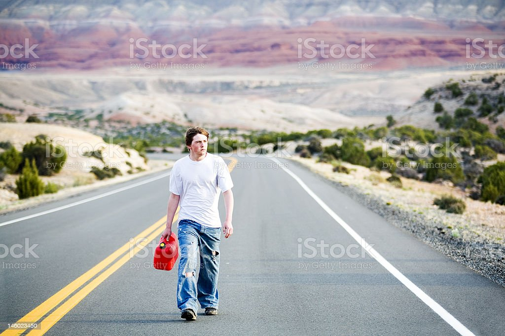 teenager out of gas royalty-free stock photo
