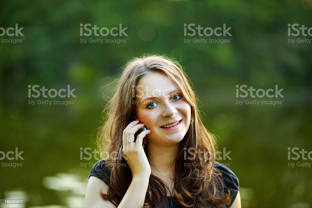 Teenager outdoor with smartphone on ear royalty-free stock photo