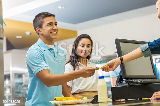 istock Teenager paying for school lunch with card in lunchroom 501263029