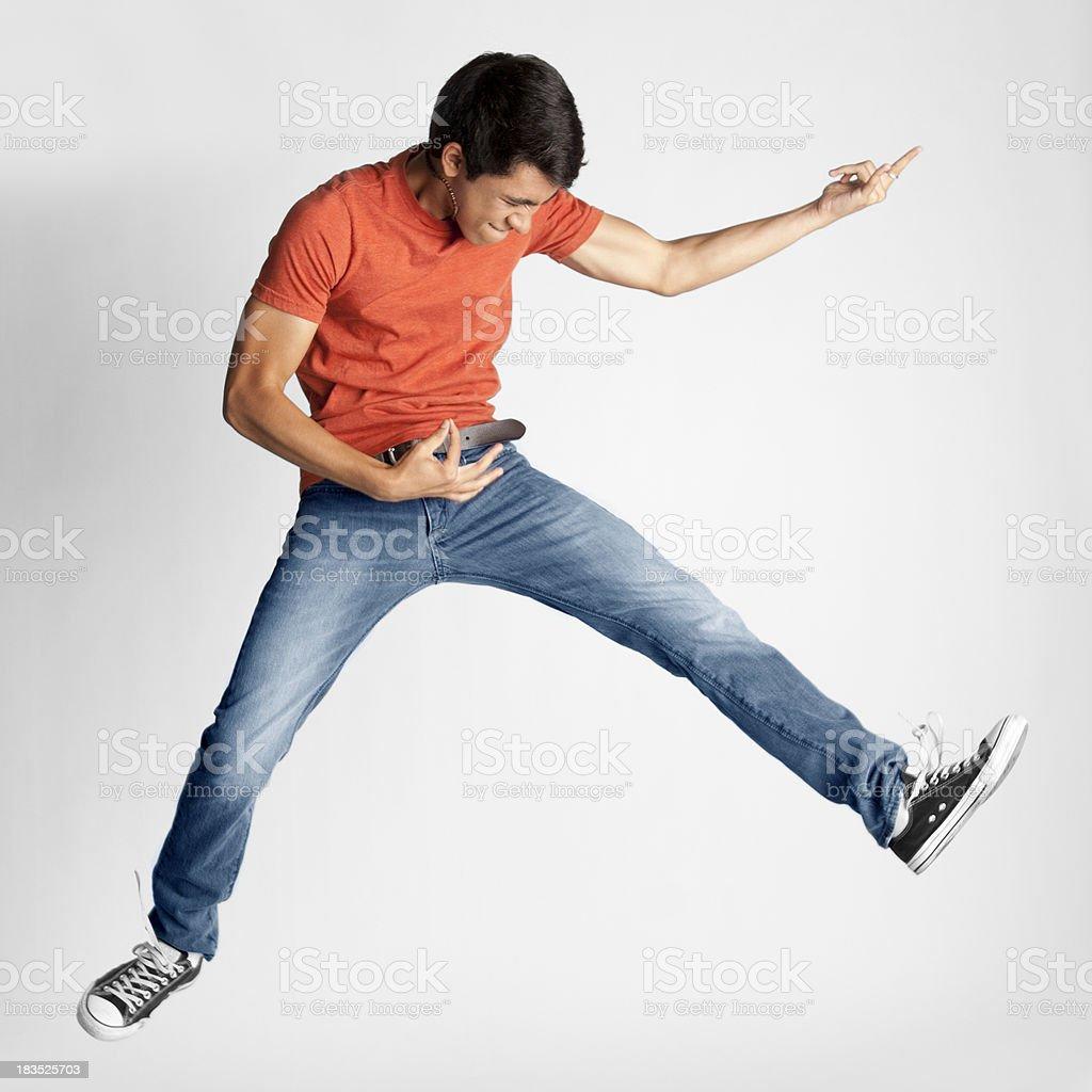 Teenager Playing Air Guitar stock photo