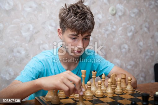 Portrait of teenager playing chess
