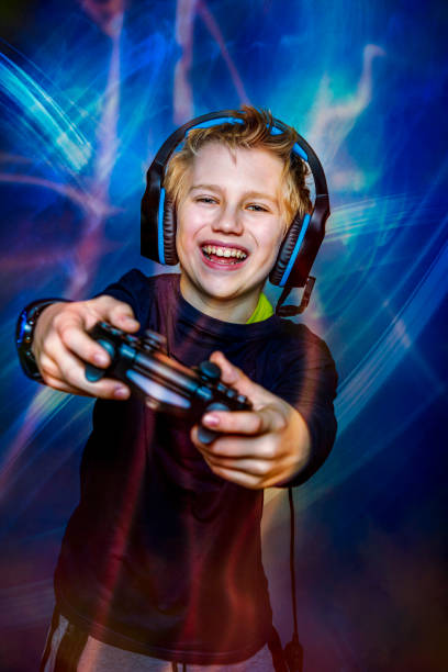 teenager playing computer games stock photo