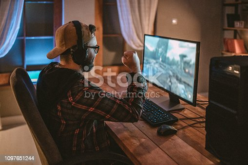 Teenager playing games on PC