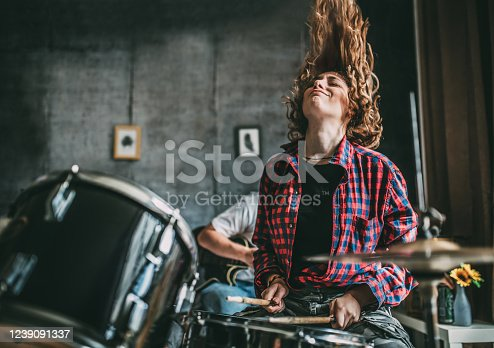 istock Teenager Playing Rock and Roll At Home 1239091337