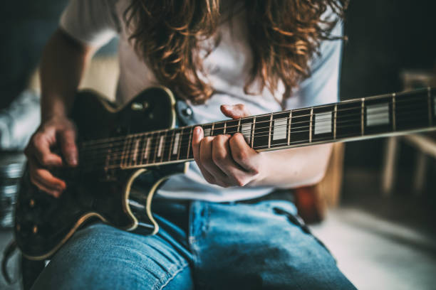Teenager Playing Rock and Roll At Home