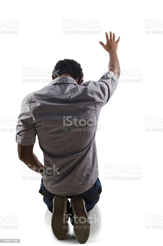 Teenager praying on his knees royalty-free stock photo