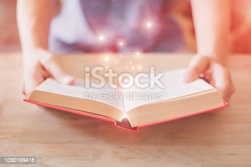 istock Teenager reading a book 1030199418