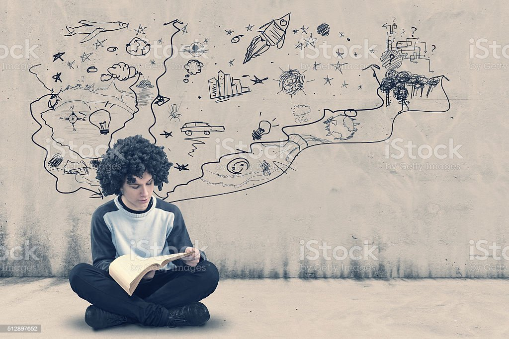 Teenager reading a book stock photo