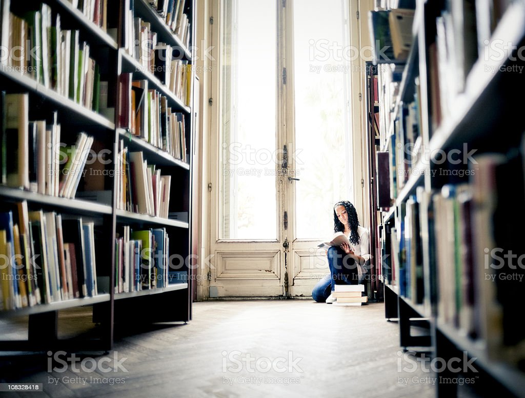 Teenager Reading in a Library royalty-free stock photo