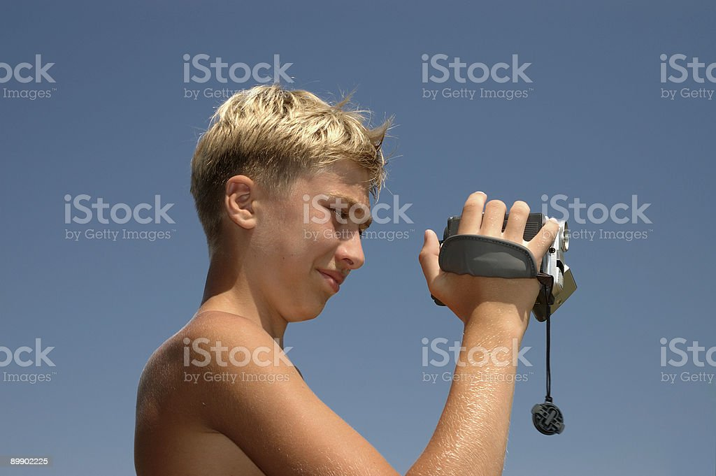 teenager removes video. royalty-free stock photo