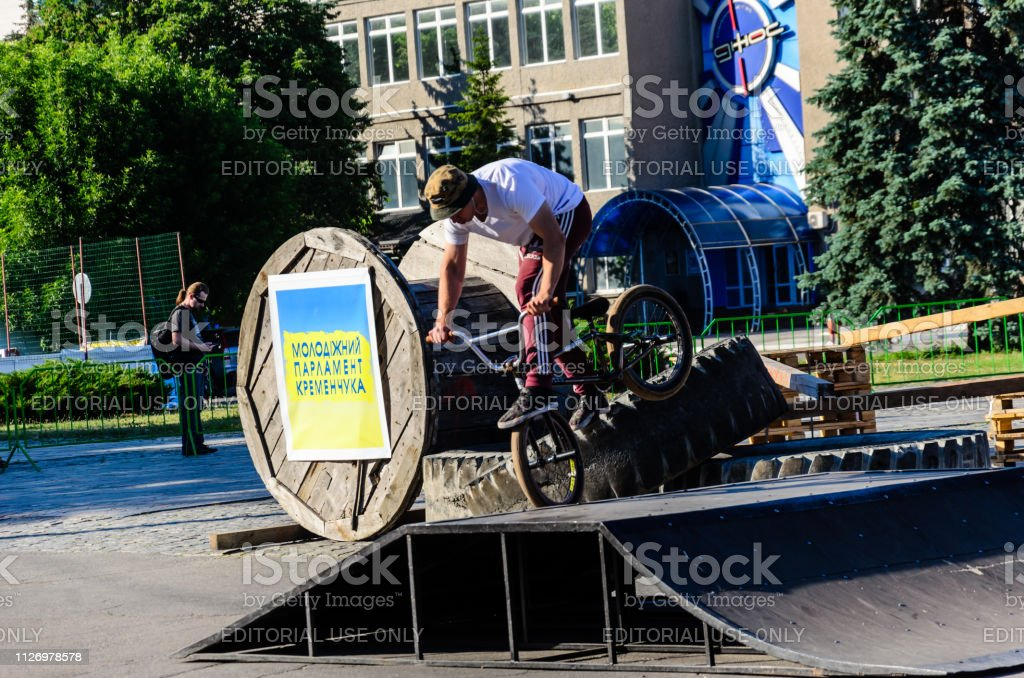 Teenager riding bmx bike during the festival of street culture