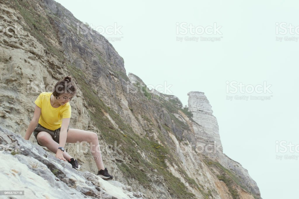 Teenager rockclimbing royalty-free stock photo