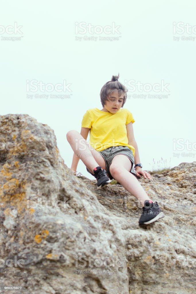 Teenager rockclimbing royalty-free stock photo